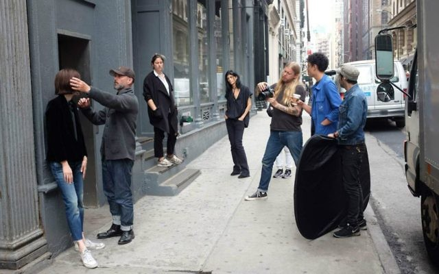 Designer Nili Lotan, third from left, watches a photo shoot of her new denim collection on a New York City street (Courtesy Nili Lotan)