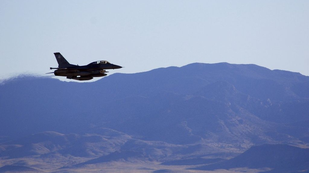 In this March, 2017, photo supplied by Sandia National Laboratories, an F-16C makes a pass over Nevada's Tonopah Test Range after a March test of a mock nuclear weapon as part of a life extension program for the B61-12, near Tonopah, Nevada. (John Salois/Sandia National Laboratories via AP)