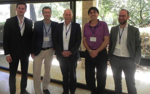 Members of Bar Ilan's QUEST Center, Prof. Avi Peer and Dr. Emanuele Dalla Torre meet in Jerusalem with the head of the European Quantum Flagship initiative, Prof. Jürgen Mlynek (Courtesy:  Segev Ben Yehuda)