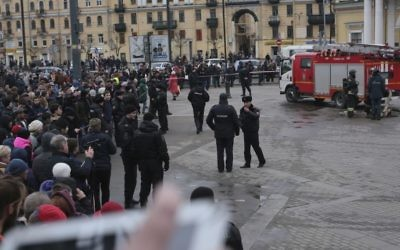 Russian police and emergency service officers block an area next to fire trucks at Sadovaya Square after explosion in St.Petersburg subway in St. Petersburg, Russia, Monday, April 3, 2017. (AP Photo/Yevgeny Kurskov)