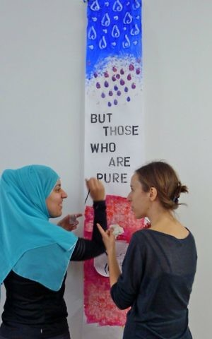 Sara Abdel-Latif (left) and Hannah Mayne participate in 'Blood, Milk & Tears' in Toronto, Canada, 2017 (Evelyn Tauben)