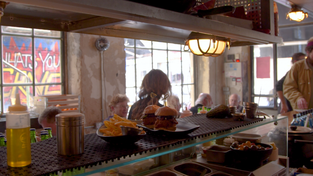 Serving it up amid the stripped walls and funky decor of Crave (Luke Tress/Times of Israel)
