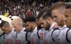 Derby County soccer players bow their heads during a minute's silence April 17, 2017, held in memory of Hannah Bladon, who was murdered in Jerusalem on April 14, 2017. Bladon was a Derby County supporter (Sky screenshot)