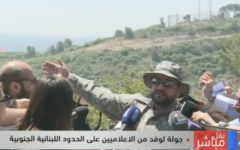 Hezbollah officer gives field tour to Lebanese journalists on the border with Israel on April 20, 2017. (Screenshot from LBC)
