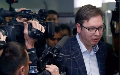Current Serbian Prime Minister and presidential candidate Aleksandar Vucic, right, arrives at a polling station to cast his ballot, in Belgrade, Serbia, Sunday, April 2, 2017. (AP Photo/Darko Vojinovic)