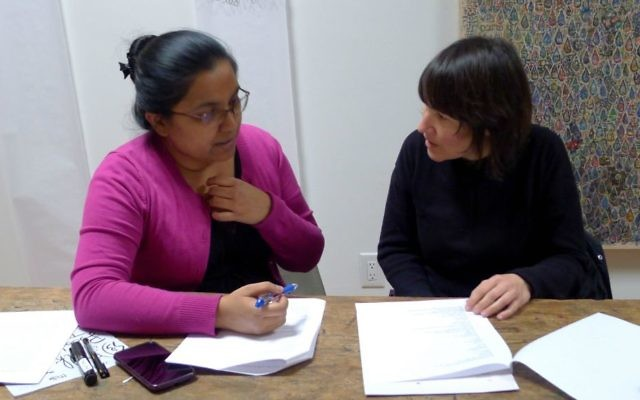 Siham Chowdhury (left) and Sharon Ross study Jewish and Muslim texts as part of 'Blood, Milk & Tears' project in Toronto, Canada, 2017 (Evelyn Tauben)