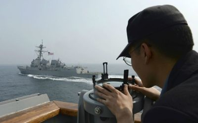In this photo provided by the South Korean Defense Ministry, a South Korean navy sailor watches the destroyer USS Wayne E. Meyer during joint exercises between the United States and South Korea in South Korea's West Sea Tuesday, April 25, 2017. (South Korean Defense Ministry via AP)