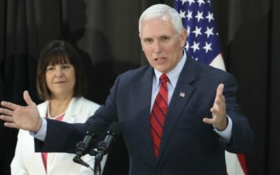US Vice President Mike Pence speaks as his wife Karen Pence listens during a dinner with soldiers and family members after Easter Sunday church services at a military base in Seoul, South Korea, Sunday, April 16, 2017. (AP Photo/Lee Jin-man)