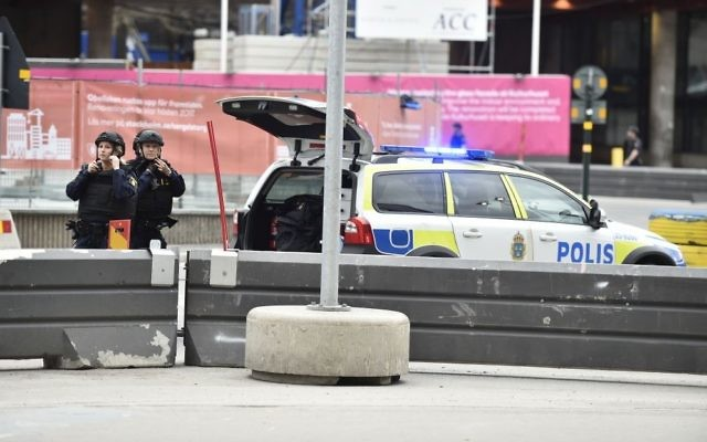Police attend the scene after a truck crashed into a department store injuring several people in central Stockholm, Sweden, Friday April 7, 2017. (Noella Johansson, TT News Agency via AP)
