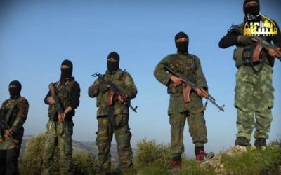 This undated photo released by the Turkistan Islamic Party, a militant website, shows fighters from the group at an unknown location in Syria. (Turkistan Islamic Party website via AP)