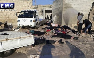 This photo provided Tuesday, April 4, 2017 by the Syrian anti-government activist group Edlib Media Center, shows victims of a suspected chemical attack, in the town of Khan Sheikhoun, northern Idlib province, Syria. (Edlib Media Center, via AP)