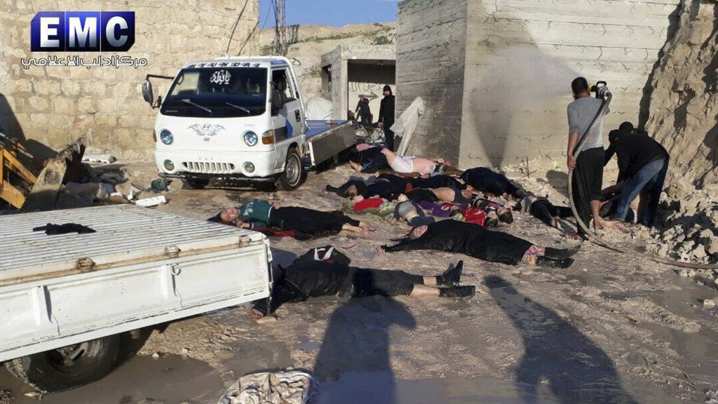 This photo provided Tuesday, April 4, 2017 by the Syrian anti-government activist group Edlib Media Center, which has been authenticated based on its contents and other AP reporting, shows victims of a suspected chemical attack, in the town of Khan Sheikhoun, northern Idlib province, Syria. (Edlib Media Center, via AP)