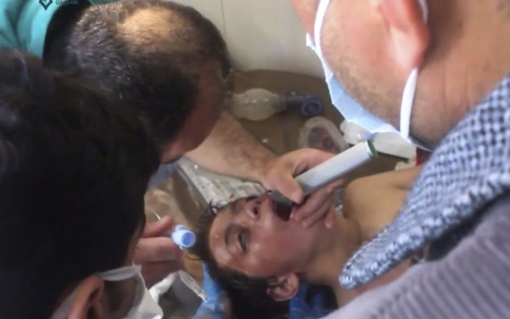 A Syrian doctor treating a boy following a suspected chemical attack, in the town of Khan Sheikhoun, northern Idlib province, Syria, from video provided on April 4, 2017. (Screen shot, Qasioun News Agency, via AP)