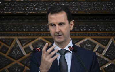 Syrian President Bashar Assad addresses the newly-elected parliament in Damascus, Syria, on June 7, 2016. (SANA, the Syrian official news agency, via AP)