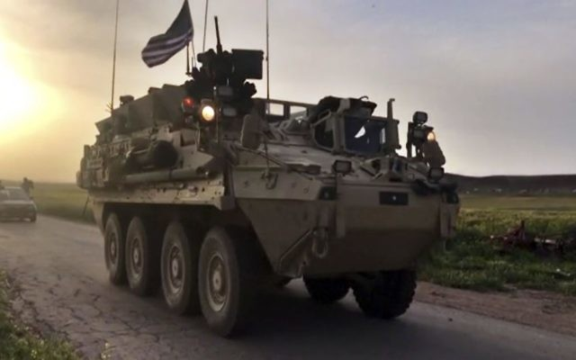 This Friday, April 28, 2017 still taken from video, shows US forces patrolling on a rural road in the village of Darbasiyah, in northern Syria. (AP Photo via APTV)