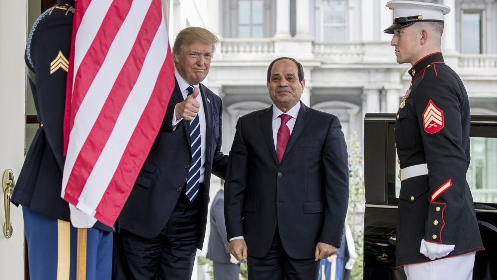President Donald Trump gives a thumbs up to members of the media as he greets Egyptian President Abdel Fattah el-Sissi at the White House on April 3, 2017. (AP Photo/Andrew Harnik)