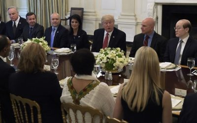 President Donald Trump, sitting next to US Ambassador to the UN Nikki Haley, speaks during a working lunch with ambassadors of countries on the United Nations Security Council and their spouses, April 24, 2017, in the State Dining Room of the White House in Washington. (AP/Susan Walsh)