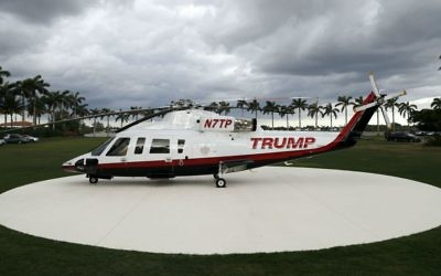 A personal helicopter of President Donald Trump sits on the helipad at Mar-a-Lago, Sunday, April 9, 2017, in Palm Beach, Florida. (AP Photo/Alex Brandon)