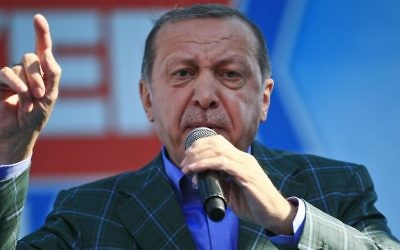 In this Saturday, April 15, 2017 photo, Turkey's President Recep Tayyip Erdogan talks to supporters during the last rally ahead of Sunday's referendum, in Istanbul. (AP Photo/Lefteris Pitarakis, file)