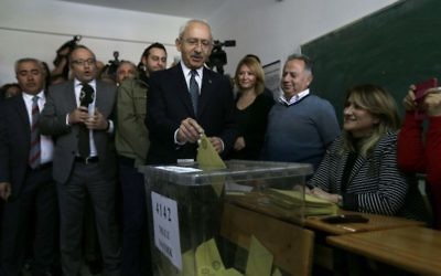 Leader of Turkey's main opposition Republican People's Party (CHP) Kemal Kilicdaroglu, center, casts a ballot inside a polling station in Ankara, on Sunday, April 16, 2017. (AP/Burhan Ozbilici)