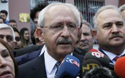 Kemal Kilicdaroglu, leader of Turkey's main opposition Republican People's Party (CHP), makes statements outside a polling station in Ankara, on Sunday, April 16, 2017. (AP/Burhan Ozbilici)
