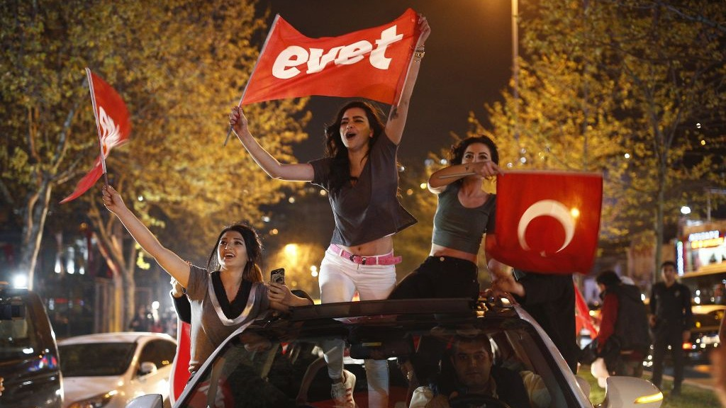 "Supporters of the ""Yes"" vote, wave flags during celebrations in Istanbul, on Sunday, April 16, 2017. (AP Photo/Emrah Gurel)"