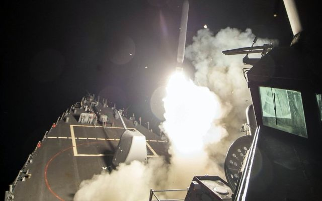 In this image provided by the US Navy, the USS Ross (DDG 71) fires a Tomahawk missile Friday, April 7, 2017, from the Mediterranean Sea. (Mass Communication Specialist 3rd Class Robert S. Price/US Navy via AP)