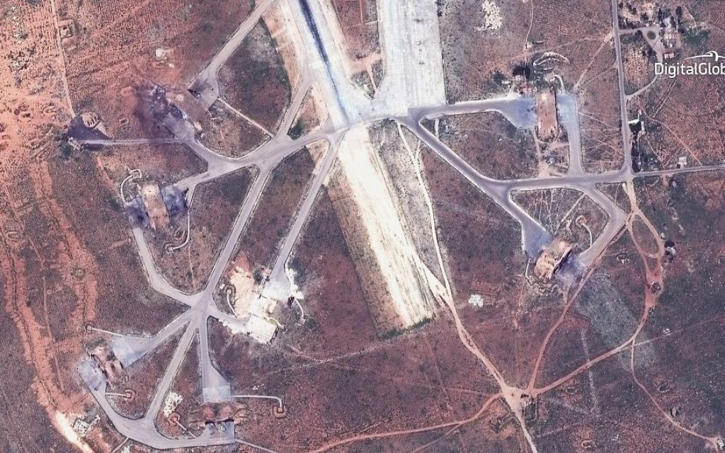 This satellite image provided by DigitalGlobe shows an image captured on April 7 of destroyed aircraft shelters on the southeast side of the Shayrat air base in Syria, following US Tomahawk Land Attack Missile strikes on Friday, April 7, 2017 from the USS Ross (DDG 71) and USS Porter (DDG 78). (DigitalGlobe via AP)