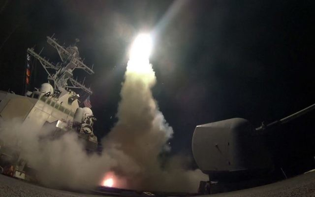 In this image provided by the US Navy, the guided-missile destroyer USS Porter (DDG 78) launches a tomahawk land attack missile in the Mediterranean Sea, Friday, April 7, 2017. (Mass Communication Specialist 3rd Class Ford Williams/US Navy via AP)