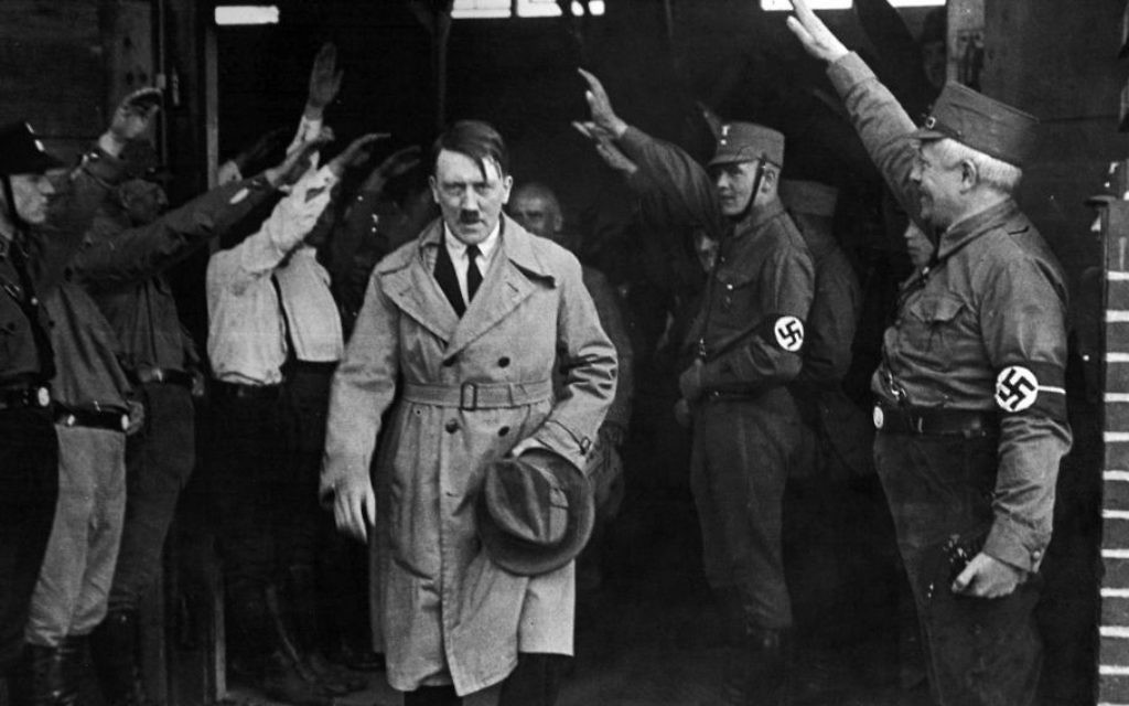 In this Dec. 5, 1931 file photo, Adolf Hitler, leader of the National Socialists, is saluted as he leaves the party's Munich headquarters.  (AP, File)
