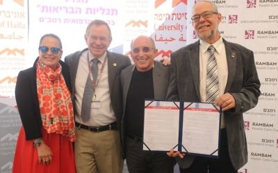 Dr. Esty Golan, far left, director of Rambam Health Care Campus; Prof. Rafi Beyar; University of Haifa President Prof. Ron Robin, University of Haifa Prof. Gustavo Mesch, far right, at the unveiling of Haifa University and Rambam hospital partnership (Courtesy University of Haifa)