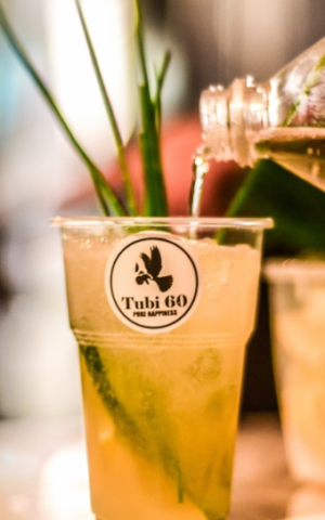 A Tubi 60 cocktail with tonic water and a sprig of rosemary (Courtesy Tubi60.com)