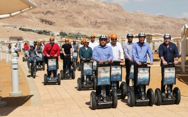 Tourism Minister Yariv Levin, center front, takes a segway tour of the new promenade along Ein Boqek on April 3, 2017. (courtesy Mickey Lengental)