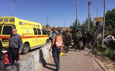 Medics and soldiers respond to a suspected car-ramming attack outside the Ofra settlement in the central West Bank on April 6, 2017. (Magen David Adom)