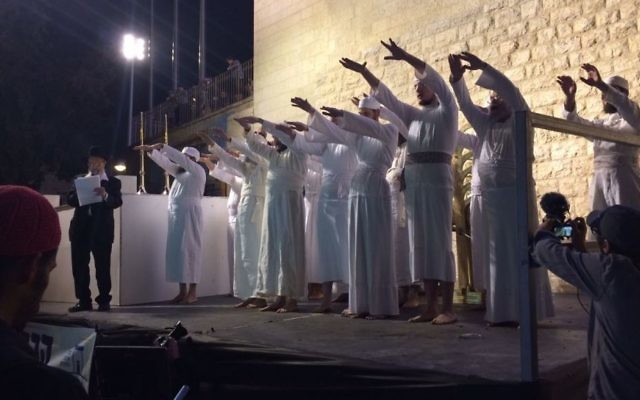 Priests recite biblical priestly blessing following the demonstration Passover sacrifice, Jerusalem, April 6, 2017 (Alexander Fulbright/Times of Israel)