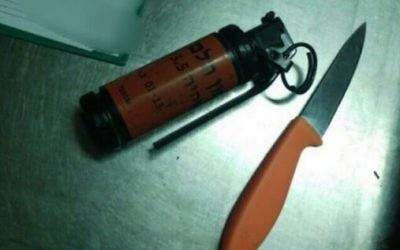 A knife and stun grenade found in the possession of a Palestinian suspect who admitted during investigation that he planned a stabbing attack in Jerusalem, April 10, 2016. (Israel Police spokesperson)