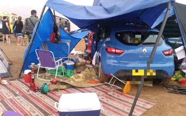 Photo of car that rolled into tent of holidaying family injuring mother, April 13, 2017 (MDA spokesperson)