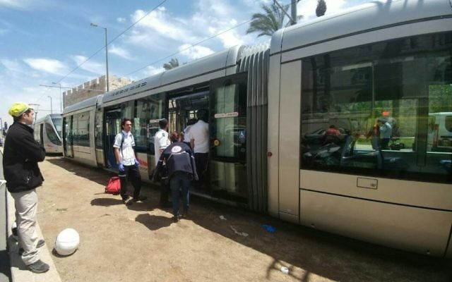Medics arrive at the scene of a stabbing attack on the Jerusalem light rail near IDF Square in the capital on April 14, 2017. (Magen David Adom)