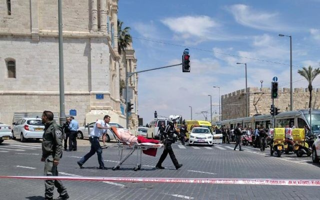 Medics take away a wounded person from the scene of a stabbing attack on the Jerusalem light rail near IDF Square in the capital on April 14, 2017. (Magen David Adom)