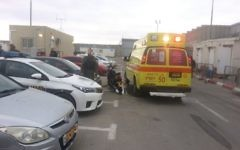 Medics arrive on the scene to treat a female security guard who was stabbed near the Qalandiya crossing in the central West Bank on April 24, 2017. (Magen David Adom)