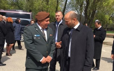 IDF Chief of Staff Gadi Eisenkot (r) and Education Minister Naftali Bennett join participants in the March of the Living in Auschwitz concentration camp, April 24, 2017 (Courtesy)