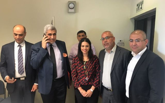 MK (Joint list) Osama Saadi stands to the right of Justice Minister Ayelet Shaked on April 25, 2017, after the two officials help appoint Israel's first female Sharia judge. (Courtesy)