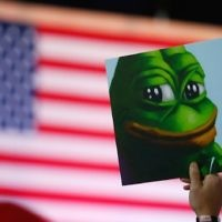 Illustrative: A Donald Trump supporter holds a poster of Pepe the Frog, a symbol of the alt-right movement, at a campaign event in Bedford, New Hampshire, on September 29, 2016. (Jessica Rinaldi/The Boston Globe via Getty Images/JTA)