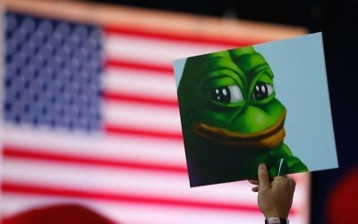 A Donald Trump supporter holding a poster of Pepe the Frog, a symbol of the alt-right movement, at a campaign event in Bedford, New Hampshire, Sept. 29, 2016. (Jessica Rinaldi/The Boston Globe via Getty Images/JTA)