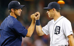 Detroit Tigers manager Brad Ausmus, left, and second baseman Ian Kinsler celebrating a win over the Seattle Mariners at Comerica Park in Detroit, July 20, 2015. They are two of the most prominent Jews in the majors this year. (Leon Halip/Getty Images/via JTA)