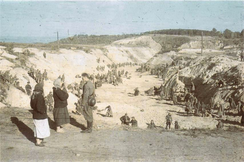 Following the September 1941 massacre of more than 33,000 Jews at Babi Yar outside Kiev, the German killers and local Ukrainians 'clean up' the ravine and gather victims' belongings (Public domain)