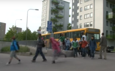 Pupils arriving by school bus at the privately-run Al-Azhar Primary School in a suburb of Stockholm, Sweden. (YouTube screenshot)