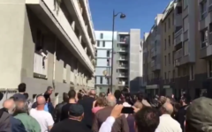Some 1,000 members of France's Jewish community gathered outside the home of Sarah Halimi in Paris to commemorate her alleged anti-Semitic murder last week, April 9, 2017. (Screen capture: 0404 Video)