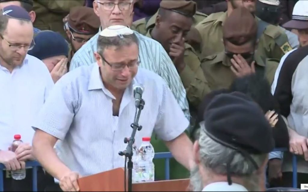 Rabbi Ohad Teharlev eulogizes his son Elhai who was killed in a car-ramming attack in the West Bank, at his funeral in Jerusalem's Mount Herzl military cemetery on April 6, 2017. (Screen capture: Ynet)