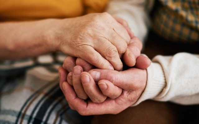 Close-up of holding seniors hands. (iStock via JTA)